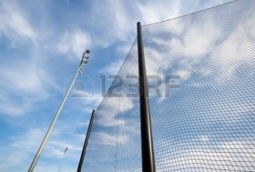 6112781-extreme-wide-angle-view-of-backstop-net-and-stadium-lights-at-baseball-or-softball-playing-field-ang